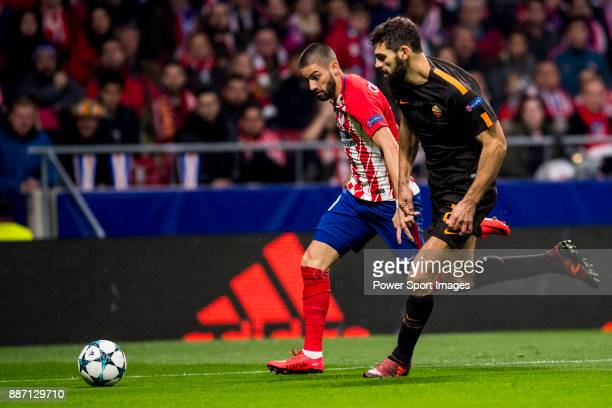 Federico Fazio of AS Roma flights the ball with Yannick Ferreira Carrasco of Atletico de Madrid during the UEFA Champions League 201718 match at...