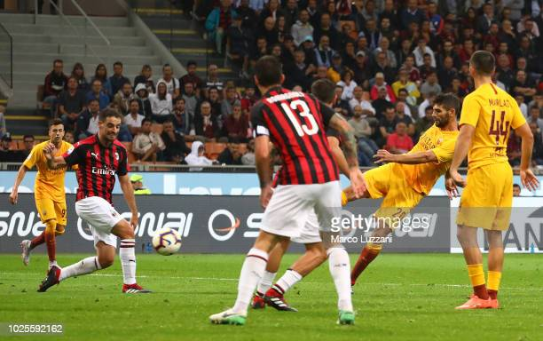 Federico Fazio of AS Roma scores the first goal of his team during the serie A match between AC Milan and AS Roma at Stadio Giuseppe Meazza on August...