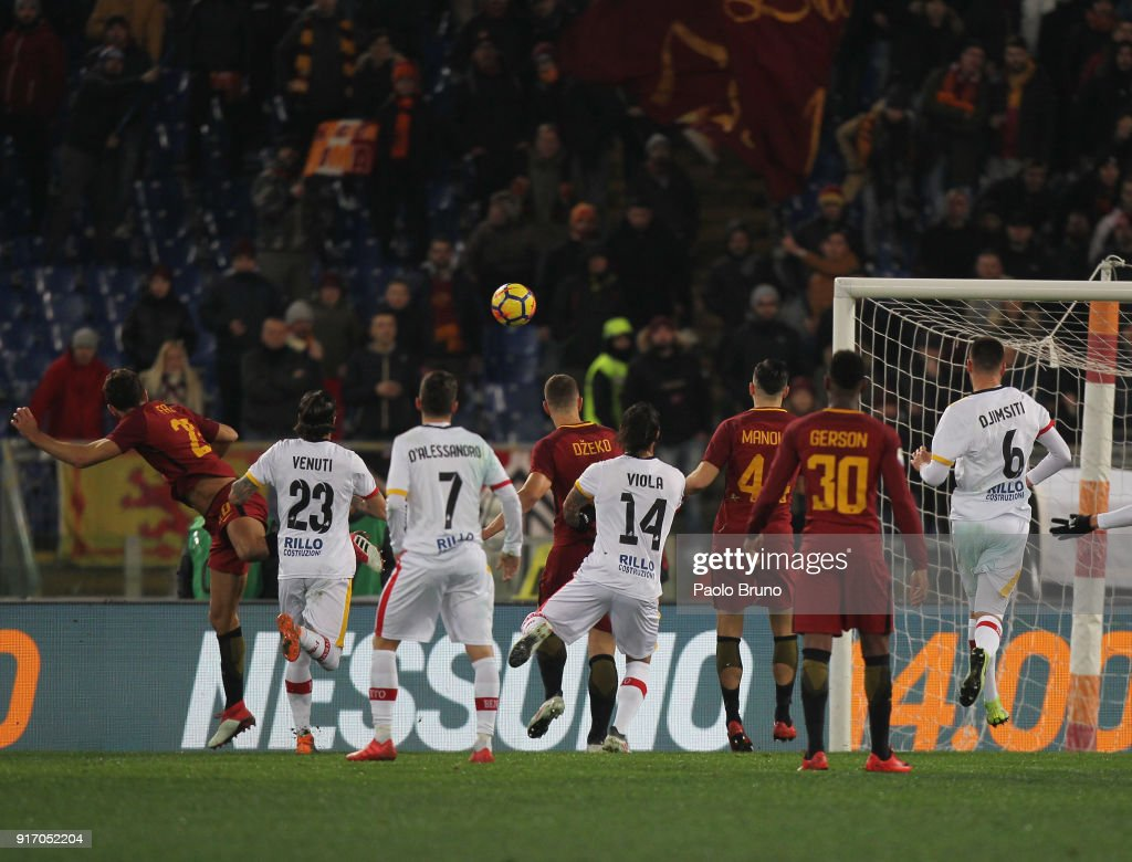 Federico Fazio (L) of AS Roma scores the team's first goal during the serie A match between AS Roma and Benevento Calcio at Stadio Olimpico on February 11, 2018 in Rome, Italy.