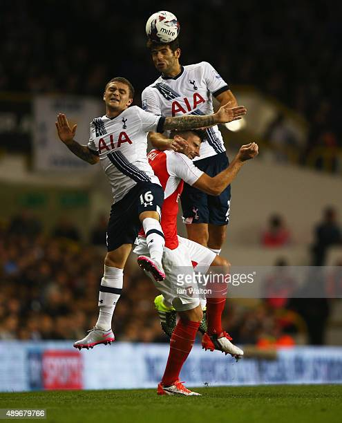 Federico Fazio of Tottenham Hotspur jumps above Kieran Trippier of Tottenham Hotspur and Olivier Giroud of Arsenal during the Capital One Cup third...