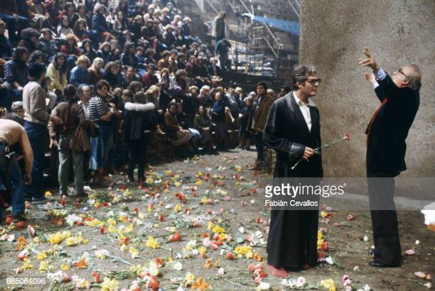 Federico Fellini directs Italian actor Marcello Mastroianni as film extras look on during the filming of his 1980 film entitled La Citta delle Donne...