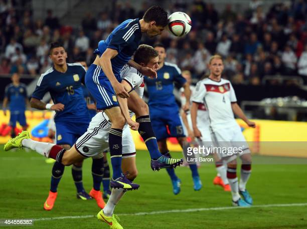 Federico Femandez of Argentina heads his teams third goal during the international friendly match between Germany and Argentina at EspritArena on...