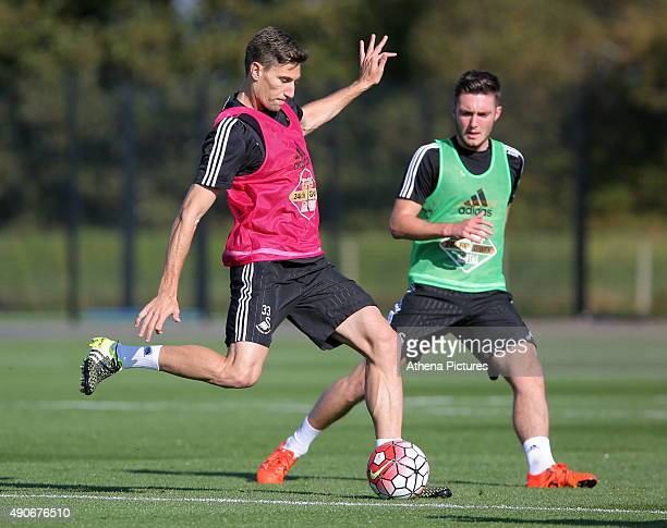 Federico Fernandez against Matt Grimes during the Swansea City Training Session at the Fairwood Training Ground on September 30 2015 in Swansea Wales