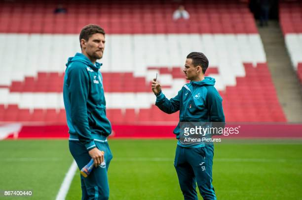 Federico Fernandez and Roque Mesa of Swansea City inspect the pitch ahead of the Premier League match between Arsenal and Swansea City at Emirates...