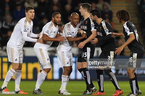 Federico Fernandez Ashley Williams and Andre Ayew of Swansea City line up against Craig Cathcart Miguel Angel Britos and Nathan Ake of Watford before...
