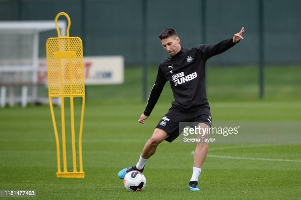 Federico Fernandez crosses the ball during the Newcastle United Training Session at the Newcastle United Training Centre on October 16 2019 in...