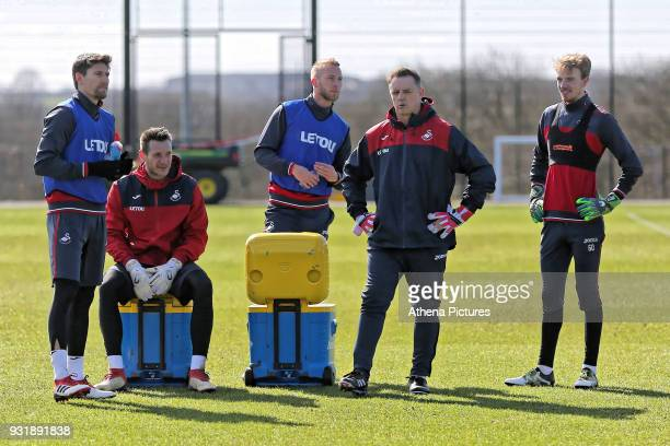Federico Fernandez Erwin Mulder Mike van der Hoorn Tony Roberts goalkeeping coach and Lewis Thomas rest during the Swansea City Training at The...