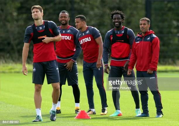 Federico Fernandez Jordan Ayew Matrin Olsso Wilfried Bony and Wayne Routledge take a short brake during the Swansea City Training at The Fairwood...