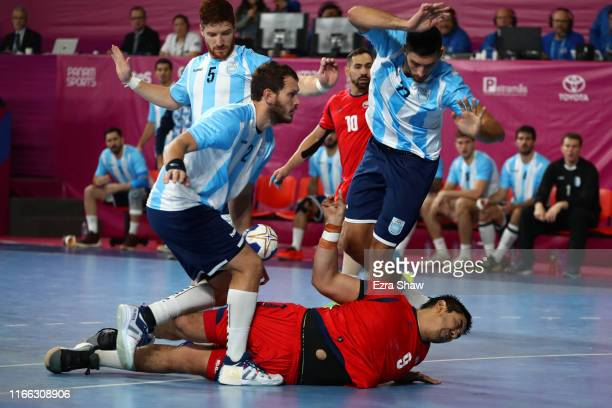 Federico Fernandez of Argentina stops Javier Frelijj of Chile in Men`s Handball Gold Medal Match between Argentina and Chile on Day 10 of Lima 2019...