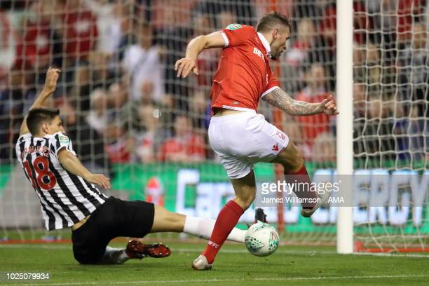 Federico Fernandez of Newcastle United blocks the shot at an open goal of Daryl Murphy of Nottingham Forest during the Carabao Cup Second Round match...