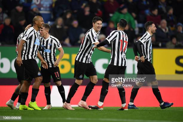 Federico Fernandez of Newcastle United celebrates with team mates as his shot deflects off Ben Mee of Burnley for their first goal during the Premier...