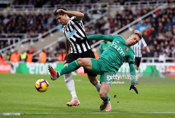 Federico Fernandez of Newcastle United is challenged by Gerard Deulofeu of Watford during the Premier League match between Newcastle United and...