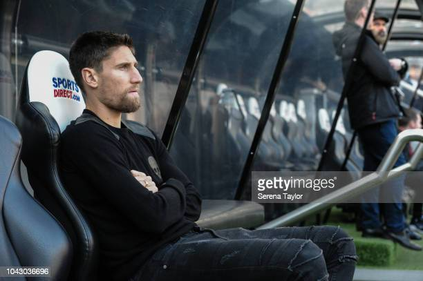 Federico Fernandez of Newcastle United sits in the dugouts prior to kick off of the Premier League Match between Newcastle United and Leicester City...