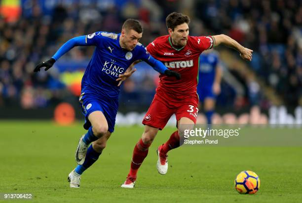 Federico Fernandez of Swansea City and Jamie Vardy of Leicester City battle for the ball during the Premier League match between Leicester City and...