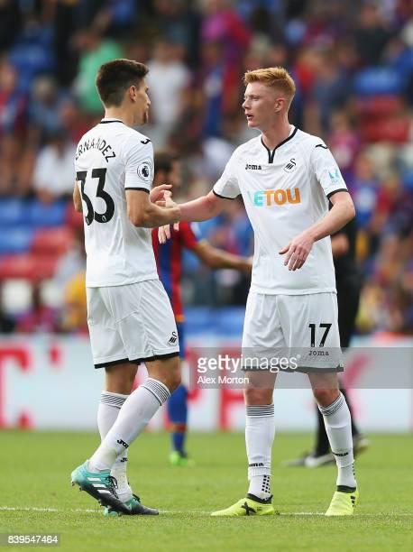 Federico Fernandez of Swansea City and Samuel Clucas of Swansea City celebrate victory together after the Premier League match between Crystal Palace...