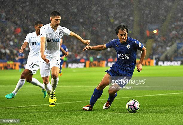 Federico Fernandez of Swansea City atttempts to hold off Shinji Okazaki of Leicester City during the Premier League match between Leicester City and...