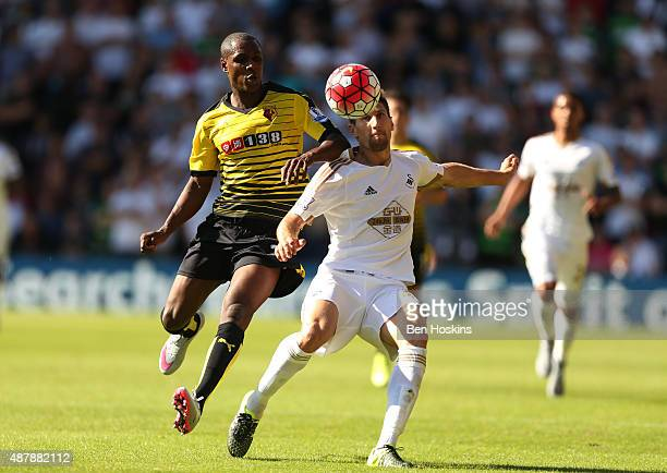 Federico Fernandez of Swansea City battles with Odion Ighalo of Watford during the Barclays Premier League match between Watford and Swansea City at...