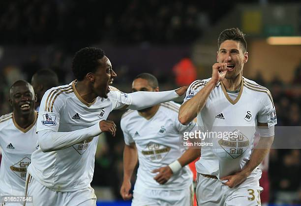 Federico Fernandez of Swansea City celebrates scoring his team's first goal with his team mate Leroy Fer during the Barclays Premier League match...