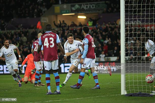 Federico Fernandez of Swansea City celebrates scoring his team's first goal with his team mates during the Barclays Premier League match between...