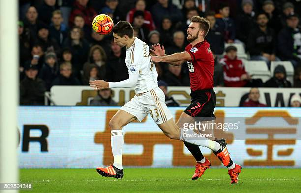 Federico Fernandez of Swansea City is challenged by James Morrison of West Bromwich Albion during the Barclay's Premier League match between Swansea...