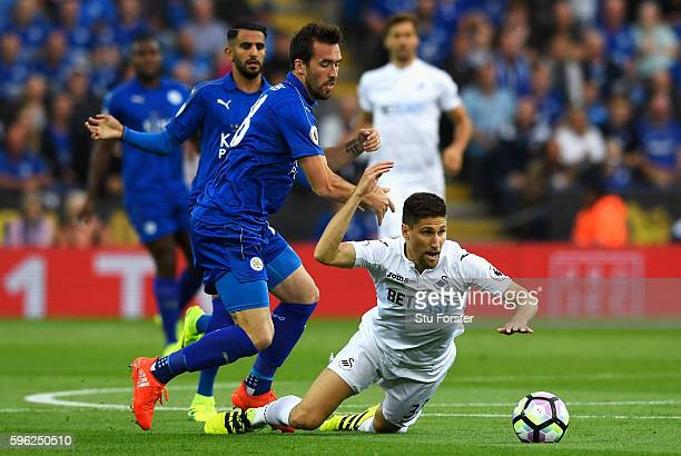 Federico Fernandez of Swansea City is fouled by Christian Fuchs of Leicester City during the Premier League match between Leicester City and Swansea...
