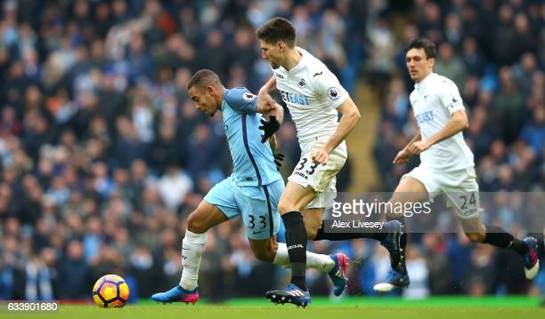 Federico Fernandez of Swansea City pulls back Gabriel Jesus of Manchester City during the Premier League match between Manchester City and Swansea...