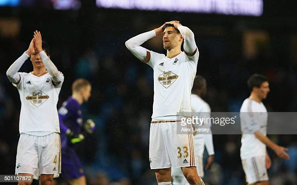 Federico Fernandez of Swansea City shows his dejection after the Barclays Premier League match between Manchester City and Swansea City at Etihad...