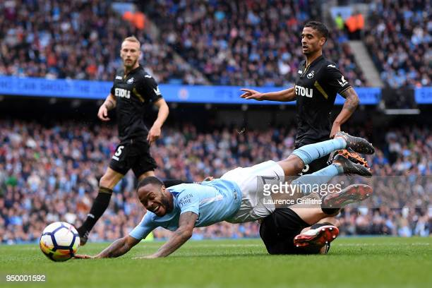 Federico Fernandez of Swansea City tackles Raheem Sterling of Manchester City leading to a penalty during the Premier League match between Manchester...