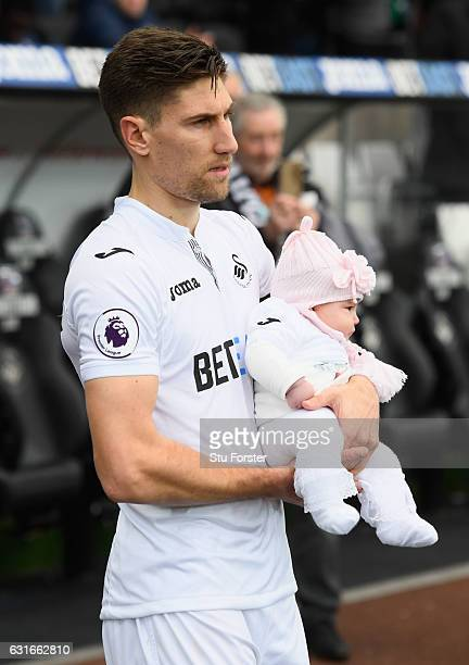 Federico Fernandez of Swansea City walks onto the pitch prior to the Premier League match between Swansea City and Arsenal at Liberty Stadium on...
