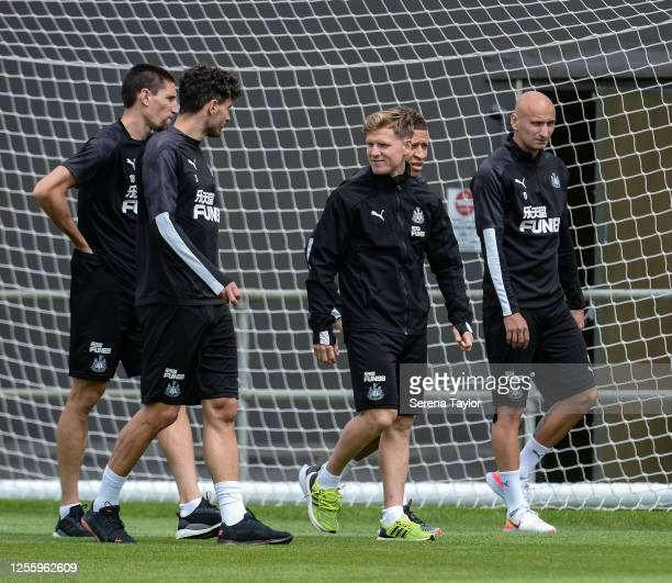 Federico Fernández Fabian Schär Matt Ritchie Dwight Gayle and Jonjo Shelvey walk outside during the Newcastle United Training Session at the...