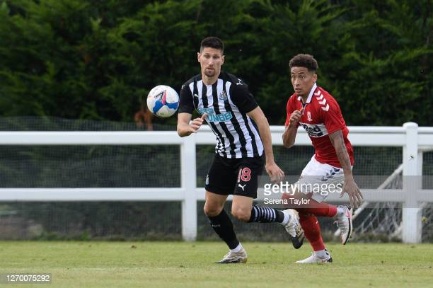 Federico Fernández of Newcastle United FC runs to the ball as Marcus Tavernier chases during the Pre Season Friendly between Newcastle United and...