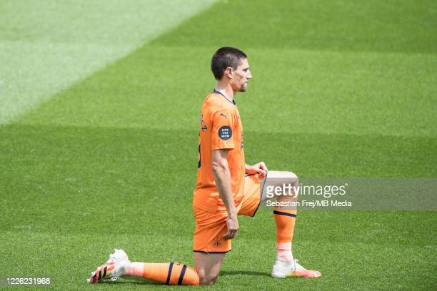 Federico Fernández of Newcastle United take a knee during the Premier League match between Watford FC and Newcastle United at Vicarage Road on July...