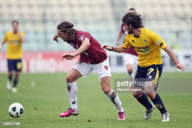 Federico Gerardi of Reggina competes for the ball with Gianni Manfrin of Modena during the Serie B match between Modena FC and Reggina Calcio at...