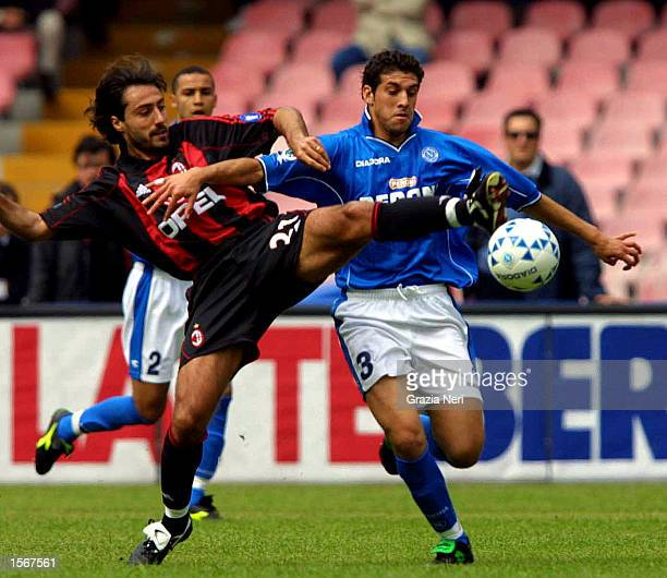 Federico Giunti of Milan and Facundo Quiroga of Napoli in action during the Serie A 25th Round League match between Napoli and AC Milan played at the...