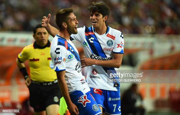 Federico Gonzalez and Carlos Orrantia of Puebla celebrate after scoring against Guadalajara during their Mexican Clausura 2017 tournament football...