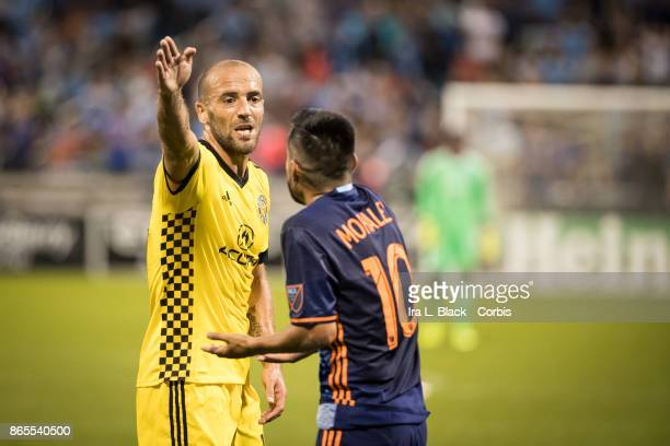 Federico Higuain of Columbus Crew argues with Maximiliano Moralez of New York City FC on a penalty call during the MLS match between New York City FC...
