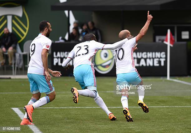 Federico Higuain of Columbus Crew celebrates with teammates Kei Kamara and Justin Meram after Hiquan scored a goal during the second half of the game...