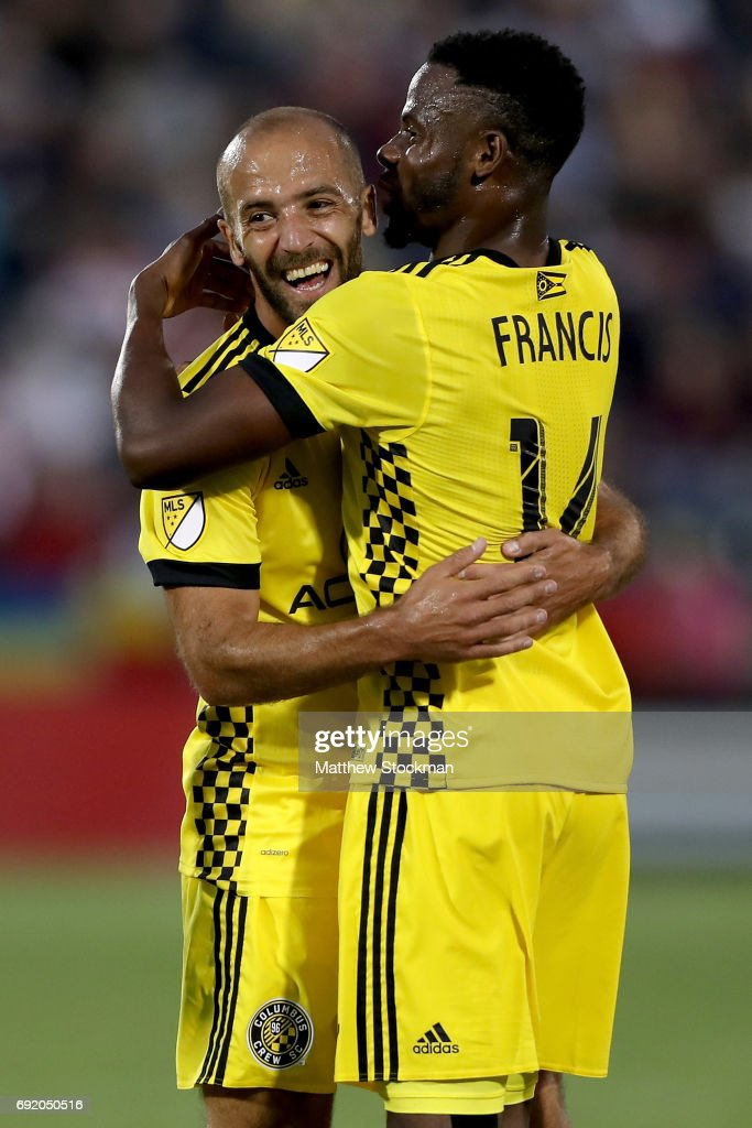 Federico Higuain #10 of the Columbus Crew SC celebrates his goal with Waylon Francis #14 against the Colorado Rapids at Dick's Sporting Goods Park on June 3, 2017 in Commerce City, Colorado.