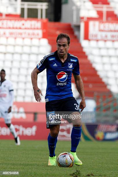 Federico Insúa of Millonarios controls the ball during a match between Once Caldas and Millonarios as part of third round of Liga Aguila I 2015 at...