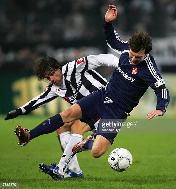 Federico Insua of Gladbach and Ivan Saenko of Nuremberg battle for the ball during the Bundesliga match between Borussia Monchengladbach and 1FC...