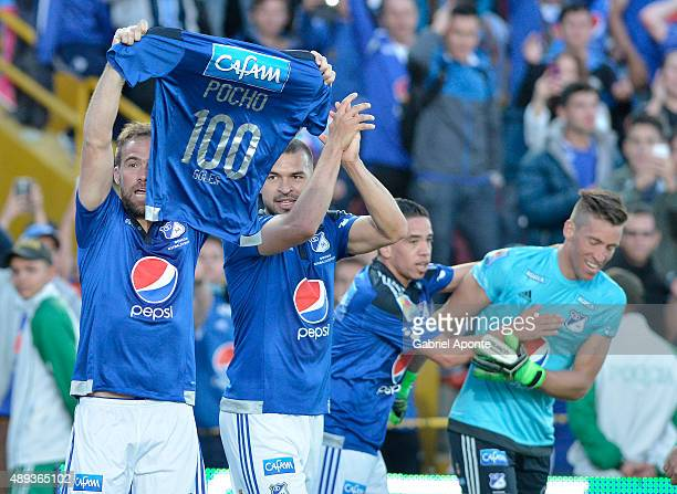 Federico Insua of Millonarios celebrates after scoring the opening goal showing a jersey with the number 100 and his nickname Pocho during a match...