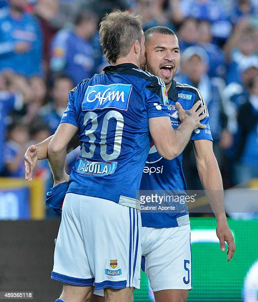 Federico Insua of Millonarios celebrates the opening goal with teammate Andrés Cadavid during a match between Millonarios and Uniautonoma as part of...