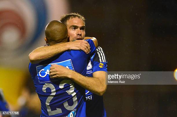 Federico Insua of Millonarios celebrates with his teammate Lewis Ochoa after scoring the first goal of his team during a second leg match between...