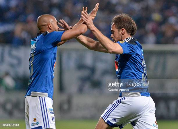 Federico Insua of Millonarios celebrates with Lewis Ochoa after scoring the first goal of his team during a match between La Equidad and Millonarios...