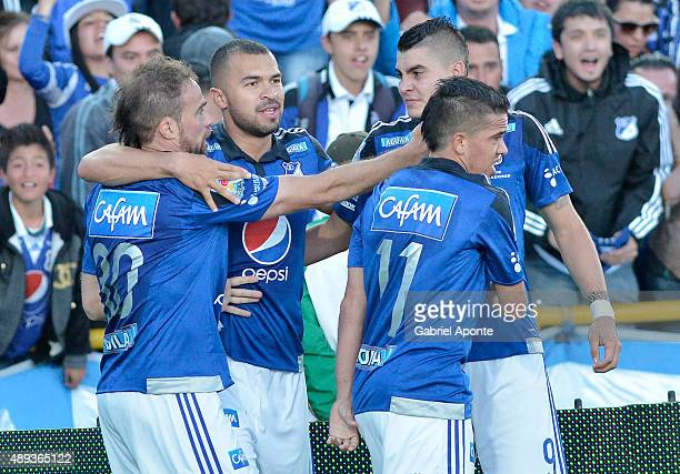 Federico Insua of Millonarios celebrates with teamates after scoring the opening goal during a match between Millonarios and Uniautonoma as part of...