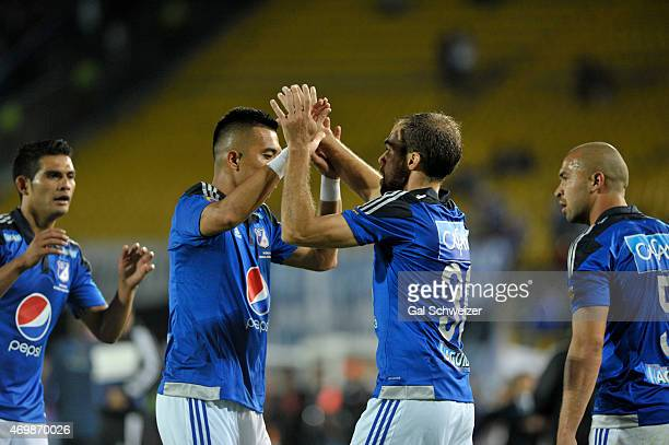 Federico Insua of Millonarios celebrates with teammates after scoring the third goal of his team during a match between Millonarios and Alianza...