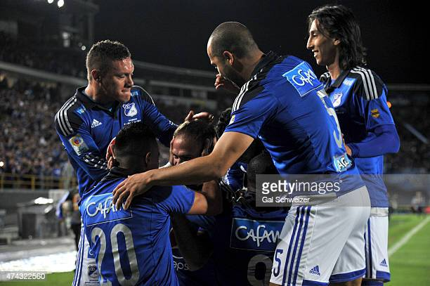 Federico Insua of Millonarios celebrates with teammates after scoring the first goal of his team during a first leg match between Millonarios and...