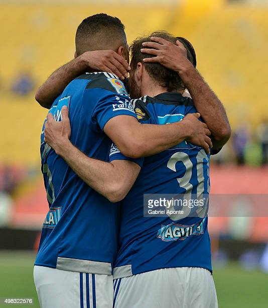 Federico Insua of Millonarios celebrates with teammates after scoring the opening goal during a match between Millonarios and Independiente Santa Fe...