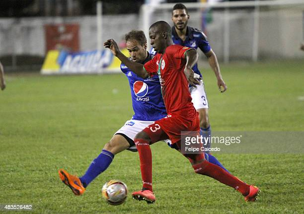 Federico Insua of Millonarios fights for the ball with Cristian Borja of Cortulua during a match between Cortulua and Millonarios as part of fifth...