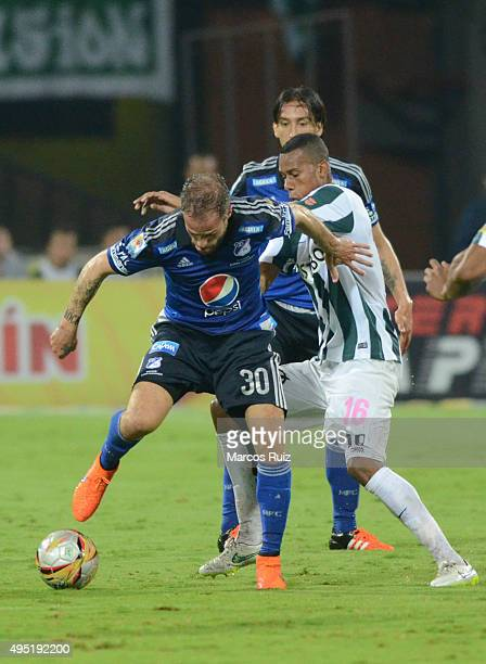 Federico Insua of Millonarios fights for the ball with Jonathan Copete of Nacional during a match between Atletico Nacional and Millonarios as part...